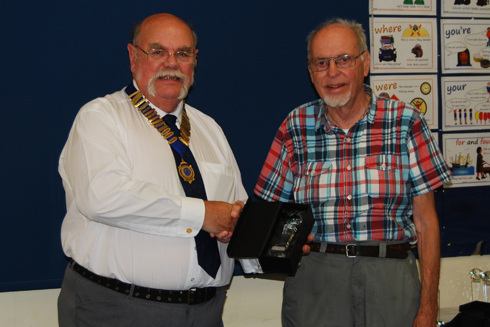 Tony G3XKT is presented with his Squares Award Diamond Trophy for 40m SSB by Geoff G7GJU
