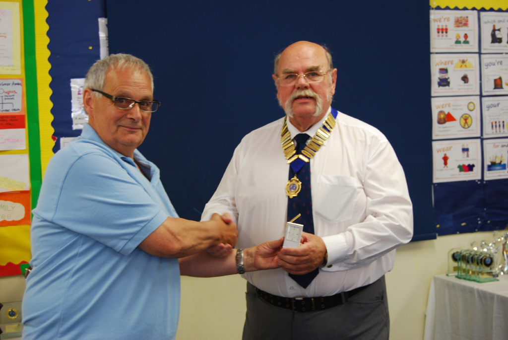 Dave G4IAR presents Geoff G7GJU with his President's Keepsake for his year in office