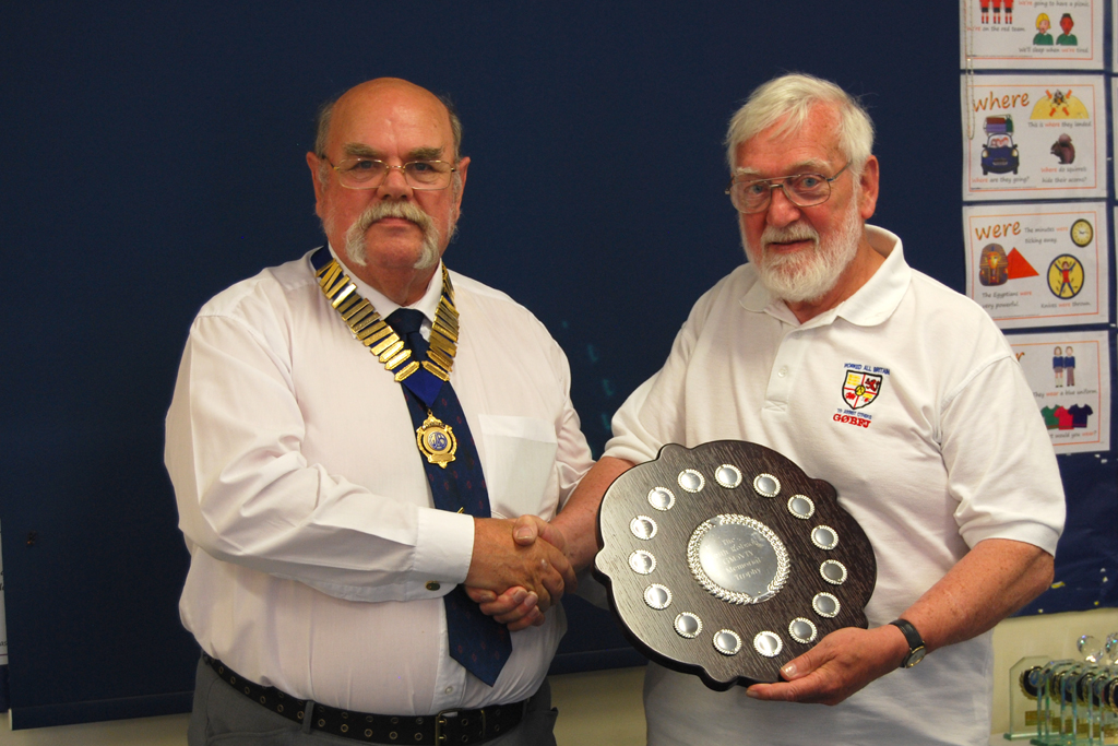 Geoff G7GJU presents Brian G0BFJ with the GM3VTY trophy, won by Denby Dale ARS G6LD
