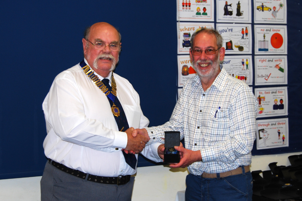Geoff G7GJU presents Gareth M0NBK with his Sapphire Award trophy