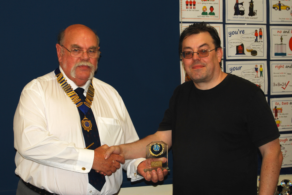 Andrew M0YMA receives his Annual Activity award from Geoff G7GJU for 336 squares activated