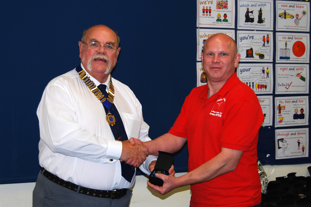 James M1TES is presented with his Sapphire Award trophy by Geoff G7GJU
