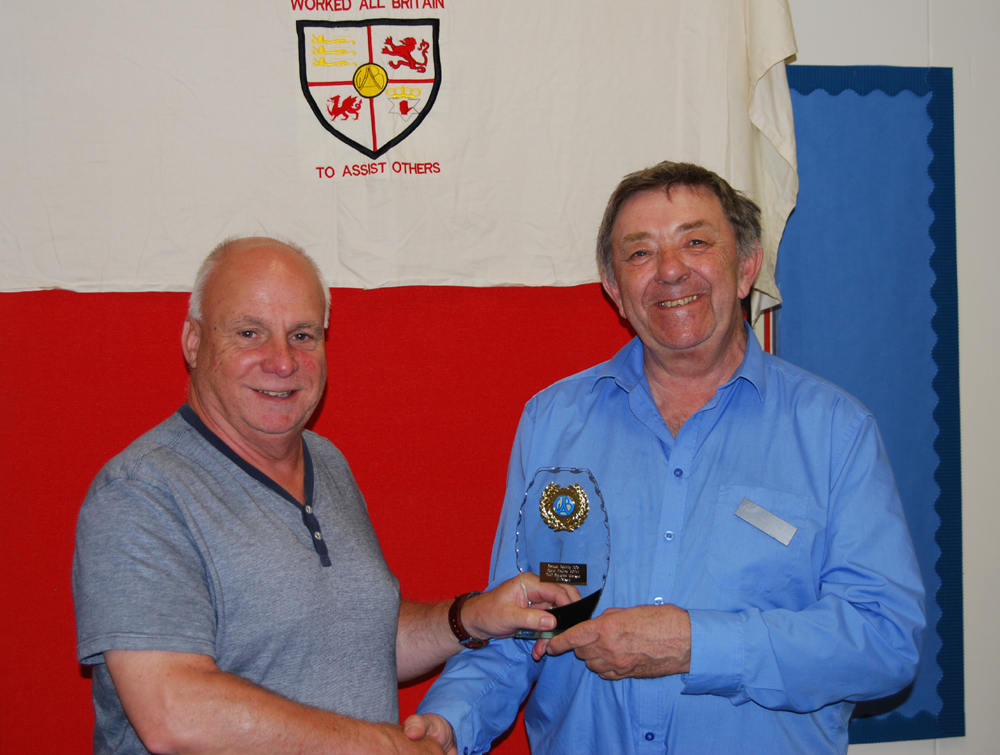 Dave G0FVH receiving his Annual Activity Award Trophy from John G8XTJ