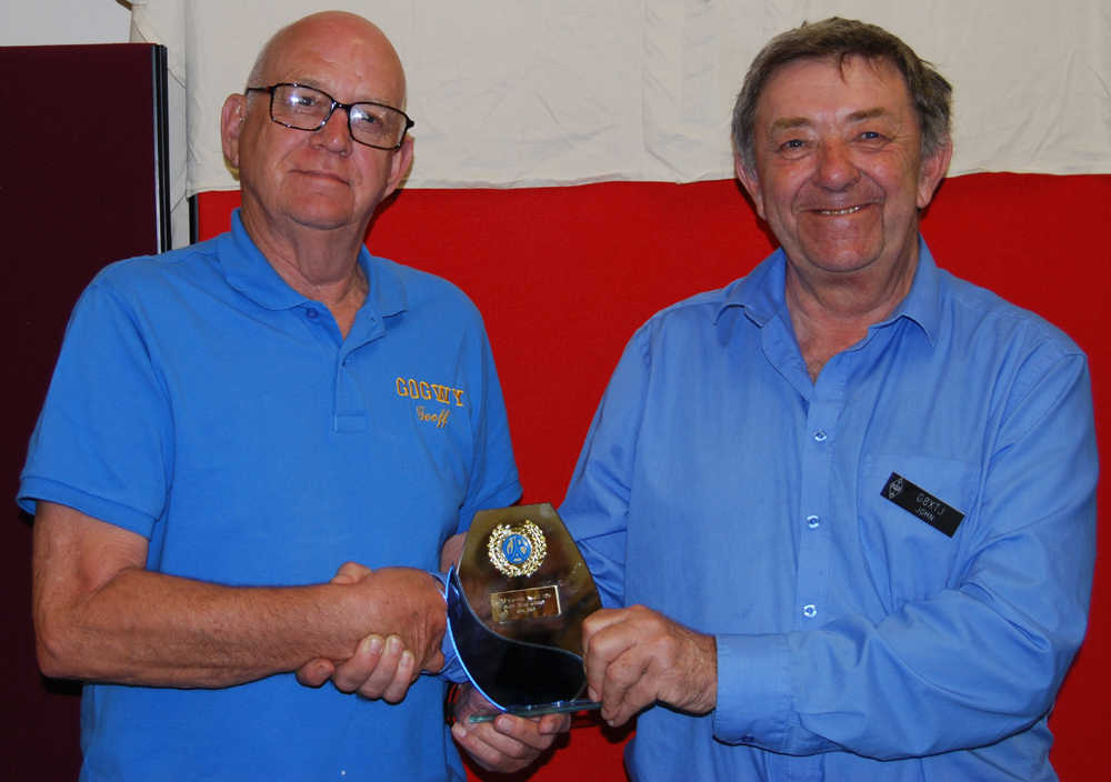 Cornish Award trophy being presented to Geoff G0GWY by John G8XTJ