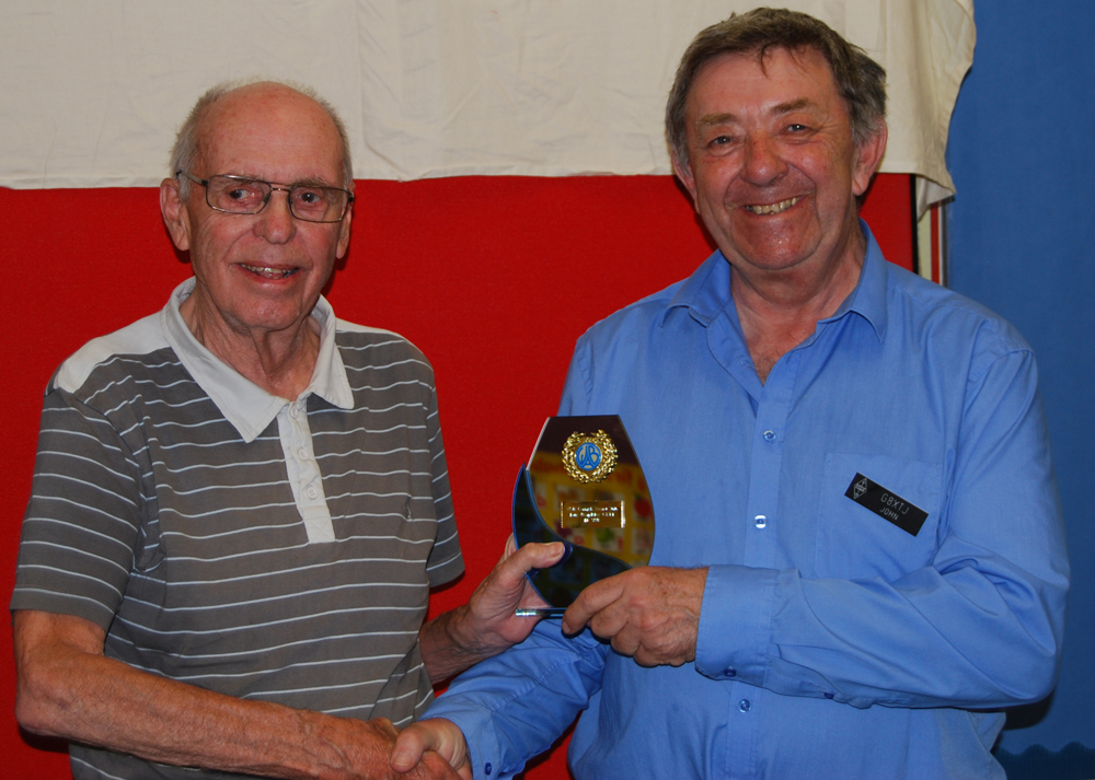 John G8XTJ presents Tony G3XKT with his Cornish Award trophy
