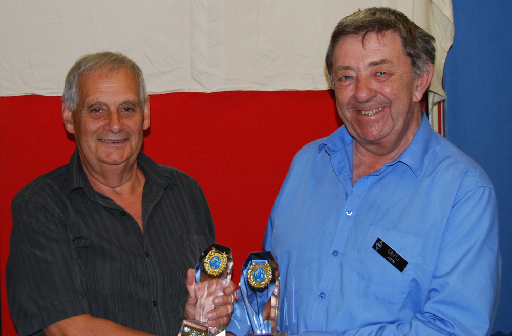 Presentation of these two VHF Challenge Trophies required some role reversal, as John G8XTJ receives them from Awards Manager Dave G4IAR