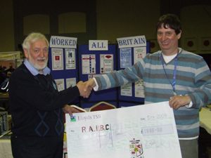 Brian Stocks G0BFJ presenting a cheque for £1000 to the R.A.I.B.C.