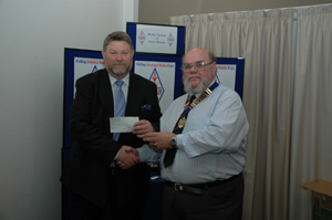 Geoff Darby G6GJU presenting a cheque for £1000 to the R.C.F.
