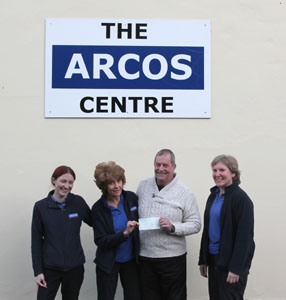 Phil Moses G7AFM presents the donation cheque to ARCOS