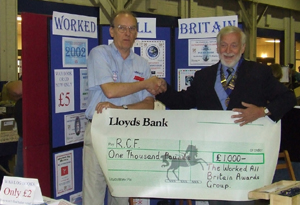 Brian Stocks G0BFJ presenting a cheque for £1000 to the Radio Communications Foundation to Angus Annan MM1CCR, RSGB President