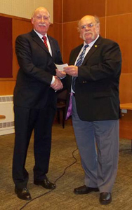 Geoff G7GJU presents donation to Tony Cowan of the U.K. Civil Air Patrol