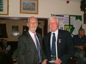 John Share G3OKA presents a cheque for £500 to the St Dunstans Amateur Radio Society